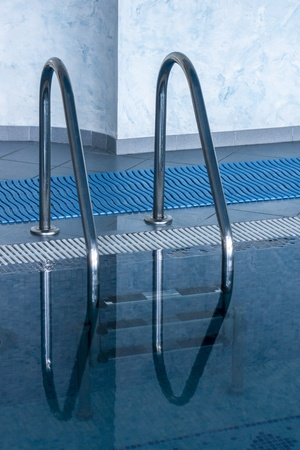 ladder in the swimming pool in spa hotel