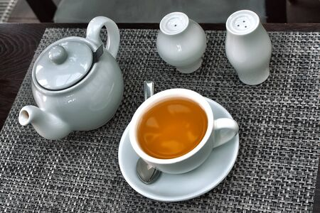 teapot and cap of tea on table
