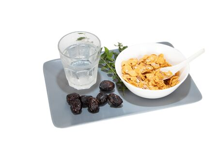 Corn flakes served with dates and cold water during fasting month of Ramadhan
