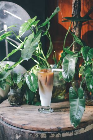 refreshing iced coffees on wooden plate. with beautiful background,A cup of iced tea or iced coffee on a wooden table, refreshing and tranquil. Suitable for relaxing on holidays.
