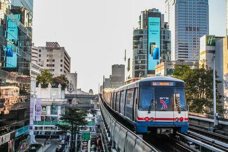 BANGKOK, THAILAND - JAN 5 : BTS Skytrain sits at a city center station, The Thai capital`s public transport rail network has a daily in Bangkok, Thailand Editorial