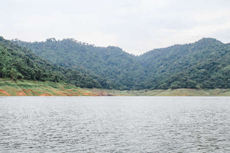 View at Kuhn Darn dam lake in Thailand.Beauty of nature concept background.Dramatic and picturesque scene.Mountain reflection on water.Popular tourist attraction. Exploration travel world.