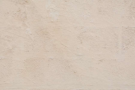Cream concrete wall texture background for design with copy space text or image. Surface natural with old pattern of tone vintage.
