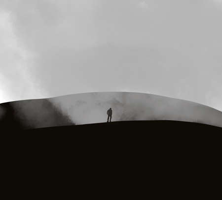 Mysterious ghostly shadow figure standing on mountain in a spooky forest. and watching over misty and foggy morning valley to Sun. With a grunge, textured edit.  イラスト・ベクター素材