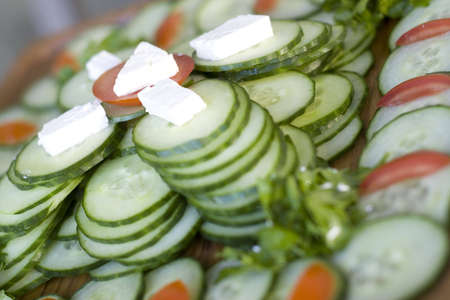 grower: Light snack from cucumber with soft cheese adn tomatoes Stock Photo