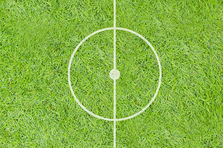 A realistic textured grass football   soccer field photo