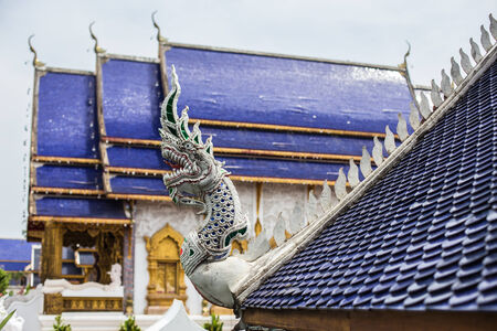 Thai art on roof Church at Thai temple photo