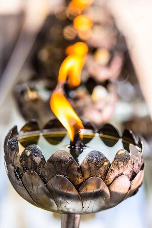 Thai style metal candle in Thai temple, Chiang Mai, Thailand  photo