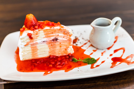 Crepe cake with strawberry sauce. photo