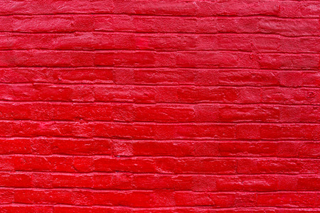 painted old wooden wall. red background. photo