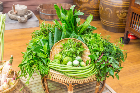 Northeastern Thai local vegetables and fruits in basket decoration. photo
