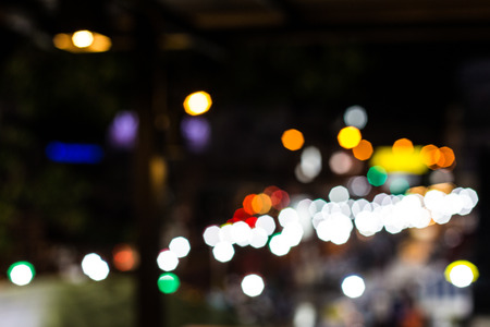 Blurred Defocused Lights of Heavy Traffic on a Wet Rainy City Road at Night - Commuting at Rush Hour Concept Stock Photo