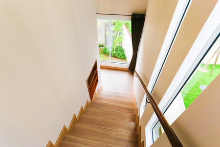 Interior - wood stairs and handrail.