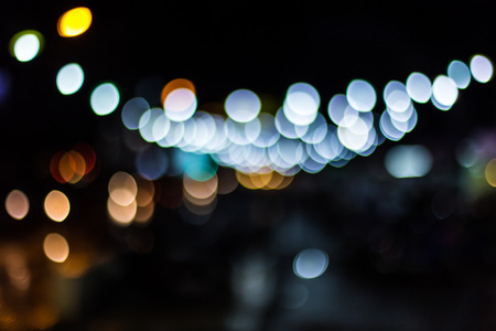 Blurred Defocused Lights of Heavy Traffic on a Wet Rainy City Road at Night . photo