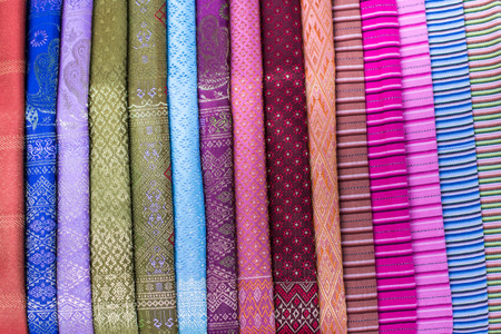 stack of traditional colourful sarong in the shop. for a background. photo