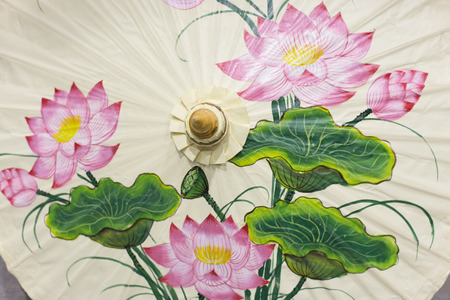 umbrella with lotus flower watercolor painting design. photo