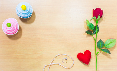 heart shaped stuff: Valentines Day gift box and rose with heart on wooden plates. Sweet holiday background Stock Photo