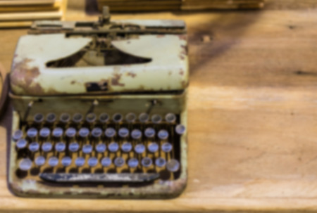 A blur background Vintage Typewriter on a wooden table photo