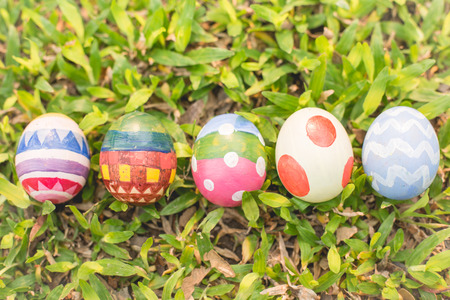 easteregg: colorful Easter egg in the fresh spring meadow. Stock Photo