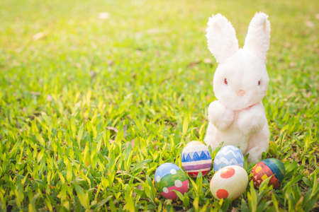 Sugar rabbit and easter eggs on meadow photo
