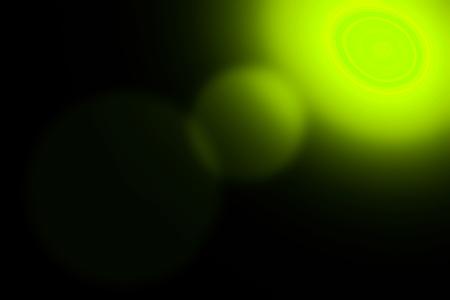 lighted: Green lighted of spot light illuminating on black background surface