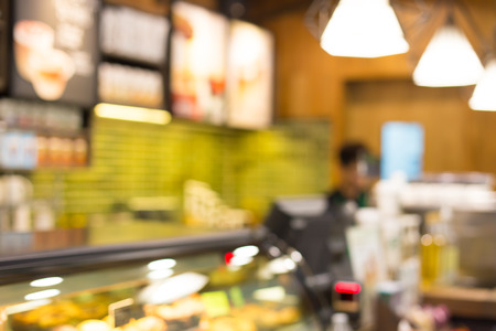 counter service: Blurred background : Vintage filter ,Barista at Coffee shop counter service blur background with bokeh. Stock Photo