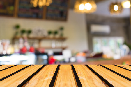 wood panel background: Selected focus empty brown wooden table and Coffee shop blur background with bokeh image Stock Photo