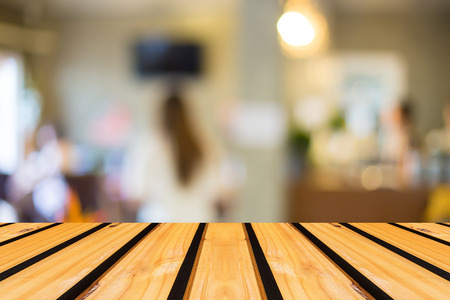 Selected focus empty brown wooden table and Coffee shop blur background with bokeh image photo