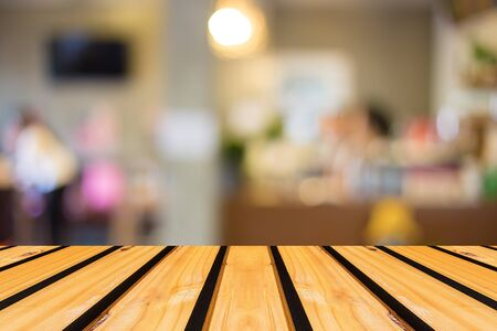 coffee table: Selected focus empty brown wooden table and Coffee shop blur background with bokeh image Stock Photo