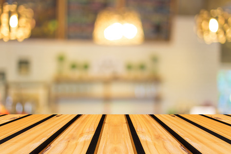 wood shelf: Selected focus empty brown wooden table and Coffee shop blur background with bokeh image Stock Photo