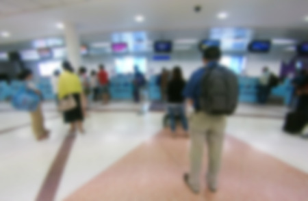 A large group of arriving business people. Panorama. Motion blur. photo