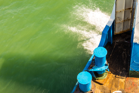 wake wash: Boat wake foam water propeller wash blue saltwater. Stock Photo