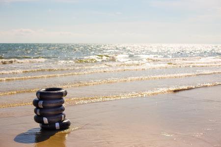 life preserver: Life preserver on sandy beach.