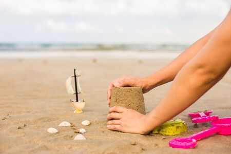 sand mold: Making a Sand Castle at the beach summer concept