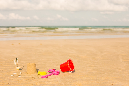bucket and spade: Shot of the beach with a spade and bucket in foreground