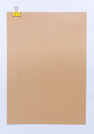 paper board: Brown sheet of paper for notes and paper clip