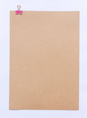 blank note: Brown sheet of paper for notes and paper clip
