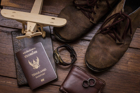 passeport: Thailand passport and traveler set on wood background, vintage and retro style.