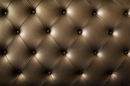 茶色のトーンで豪華な装飾の本革張り背景。 写真素材