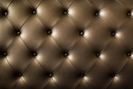 Genuine leather upholstery background for a luxury decoration in Brown tones. Stock Photo