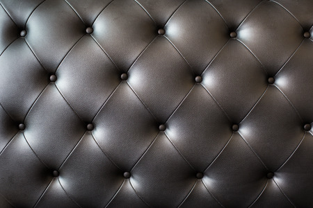 loveseat: picture of black genuine leather.