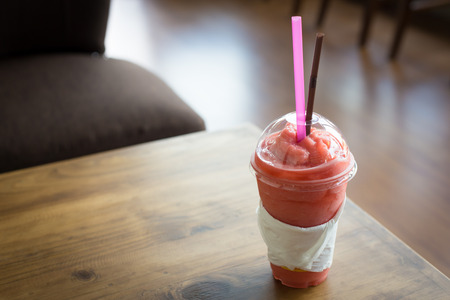 strawberry smoothie: strawberry smoothie on wooden table. Stock Photo