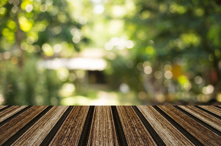 summer nature: wooden table with space for your photo montage and green color of background. Stock Photo