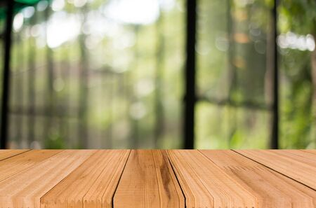 photo montage: wooden table with space for your photo montage and green color of background. Stock Photo