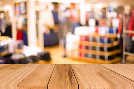 empty shelf: Empty table and blurred store with bokeh background, product display template Stock Photo