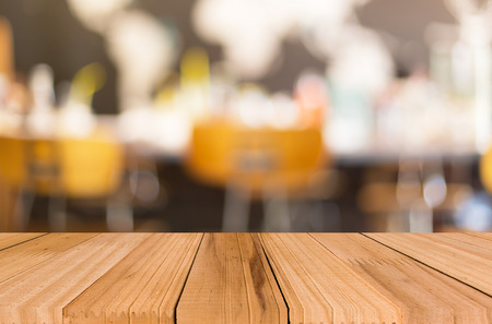 blank space: Selected focus empty brown wooden table and Coffee shop blur background with bokeh image Stock Photo
