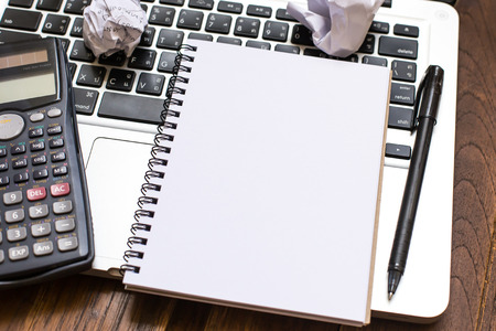 business training: Notebook an address book with blank sheets and calculator on the laptop. Business a concept idea.