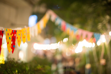 Blur background colorful triangular flags of decorated celebrate outdoor party.
