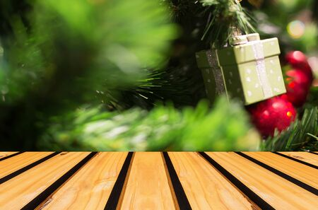 holiday lights display: Christmas holiday background with empty wooden deck table over festive bokeh. Ready for product montage Stock Photo