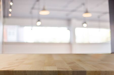 customer focus: Selected focus empty brown wooden table and Coffee shop blur background with bokeh image. for your photomontage or product display.